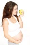 Embarazado con la manzana Fotografía de archivo