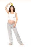 Embarazado con la manzana Foto de archivo libre de regalías