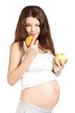 Embarazado con las manzanas Fotos de archivo libres de regalías