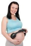 Embarazado con los auriculares Imagen de archivo