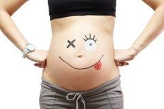 Embarazo. Panza con el relleno. Imagen de archivo