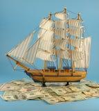 Embarcação e dólares de navigação Fotos de Stock