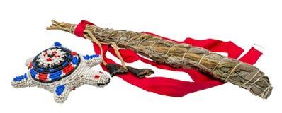 Embarcação indiana do cordão umbilical com um pacote do sábio branco para borrar na área indiana esotérico fotos de stock royalty free