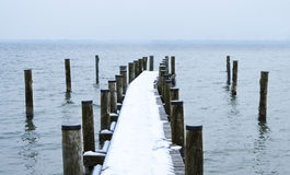Embarcadero cubierto con nieve Imágenes de archivo libres de regalías