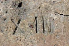 Embarcadero de la roca con Roman Thirteen Imagen de archivo libre de regalías