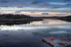 Embarcadero del pescador del fiordo en puesta del sol Imágenes de archivo libres de regalías