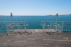 Embarcadero en el lago Issyk-Kul Foto de archivo libre de regalías