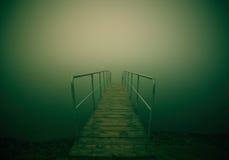 Embarcadero en la niebla Fotografía de archivo libre de regalías