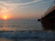 Embarcadero en la puesta del sol Foto de archivo