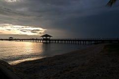 Embarcadero en la puesta del sol Imagen de archivo libre de regalías
