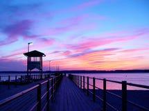 embarcadero en puesta del sol Imágenes de archivo libres de regalías