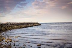 Embarcadero en puesta del sol en Cape Cod Imagen de archivo libre de regalías
