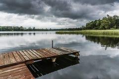 Embarcadero en un lago Fotos de archivo libres de regalías