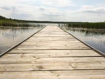 Embarcadero en un lago en Polonia Imágenes de archivo libres de regalías