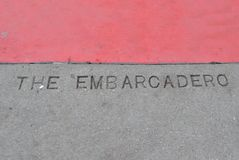 The Embarcadero. Etched into pavement stock photo