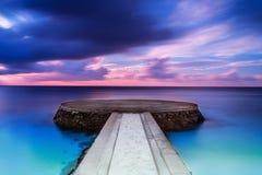 Embarcadero hermoso en puesta del sol Fotografía de archivo