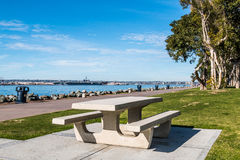 Embarcadero Marina Park North Picnic Table and Bayside Walkway. Picnic table at Embarcadero Marina Park North, with San Diego bay in the background Royalty Free Stock Photos
