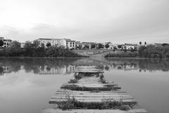 Embarcadero. Monochromatic image of a dilapidated pier in the river Guadalquivir through Cordoba, Spain, photo taken with a tripod and timer Stock Photo
