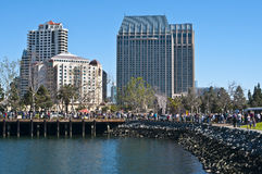 Embarcadero, San Diego. The Embarcadero walkway is full of people on a beautiful Saturday afternoon.just south of the cruise ship terminal at the San Diego royalty free stock image