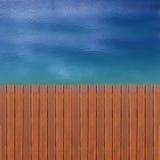 Embarcadero y azul de madera Foto de archivo libre de regalías