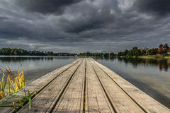 Embarcadero y lago Fotos de archivo libres de regalías