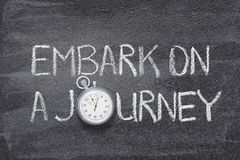 Embark a journey watch. Embark on a journey phrase written on chalkboard with vintage precise stopwatch stock photos