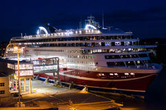 Embarking boat by night. Boat embarking during night in the Turku, Finland harbour royalty free stock photography