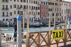 Embarking Taxis On The Grand Canal In Venice. Travel, holidays, architecture. March 28, 2015. Venice, Veneto region, Italy royalty free stock photo