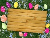 Embarquez avec les oeufs colorés de Pâques sur le pré Photos libres de droits