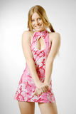 Embarrassed blonde in pink Stock Photos