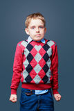 Embarrassed boy isolated Stock Photography