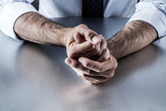 Embarrassed business man hands expressing controlled frustration and tension Royalty Free Stock Photo