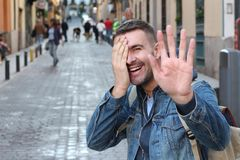 Embarrassed cute guy smiling at camera.  stock images