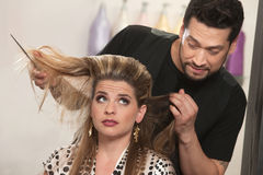 Embarrassed Hairdresser and Client Royalty Free Stock Image
