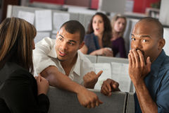 Embarrassed Man With Coworkers Stock Image