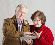 Embarrassed Man with Tablet Royalty Free Stock Images