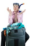 Embarrassed man with travel bag Royalty Free Stock Image