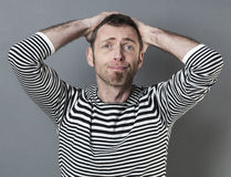 Embarrassed middle aged man Stock Images