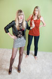 Embarrassed Mom. Embarrassed mother with daughter in revealing clothing stock images