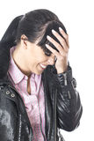 Embarrassed Mortified Young Woman Smiling With Her Hand on Forehead Smiling Stock Photography