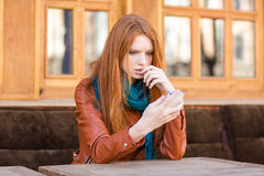 Embarrassed shoked lady reading message in mobile phone Stock Photos