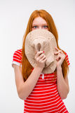 Embarrassed shy woman hiding her face behind hat Stock Photo
