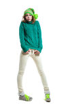 Embarrassed winter girl. Full length portrait of young funny surprised winter girl wearing warm woolen knitted sweater, yellow green bright hat with pom pon Royalty Free Stock Photo