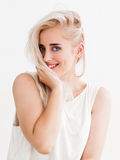 Embarrassed woman  smiling and flirting Royalty Free Stock Photos
