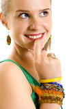 Embarrassed young blond woman Royalty Free Stock Photography