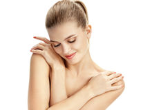 Embarrassed young lady with arms crossed over her chest. royalty free stock photo
