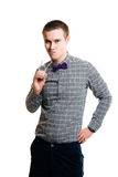 Embarrassed young man holding glasses Royalty Free Stock Photo