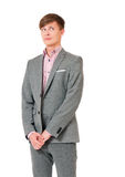 Embarrassed young man. Looking away for shyness, shame or humiliation, isolated on white background stock photos