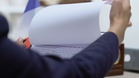 Embassy clerk looking through French visa application, marking approved. Stock footage stock video