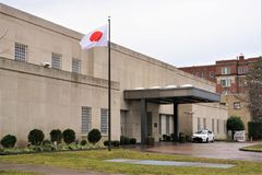 Embassy of Japan and flag in Washington DC. The embassy personnel offices for the country of Japan in Washington DC. White rectangular flag with red circle stock image